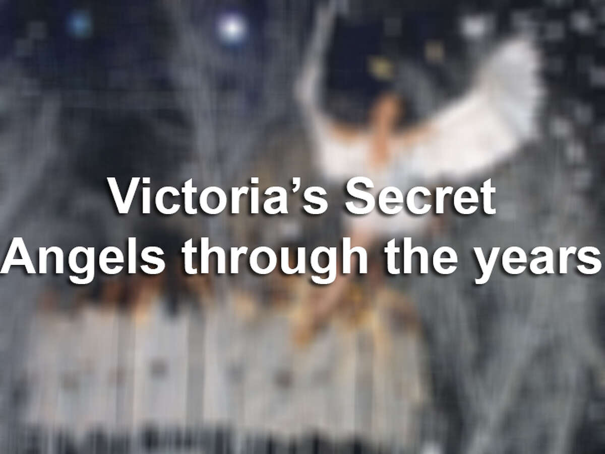Victoria's Secret angels changing wings.