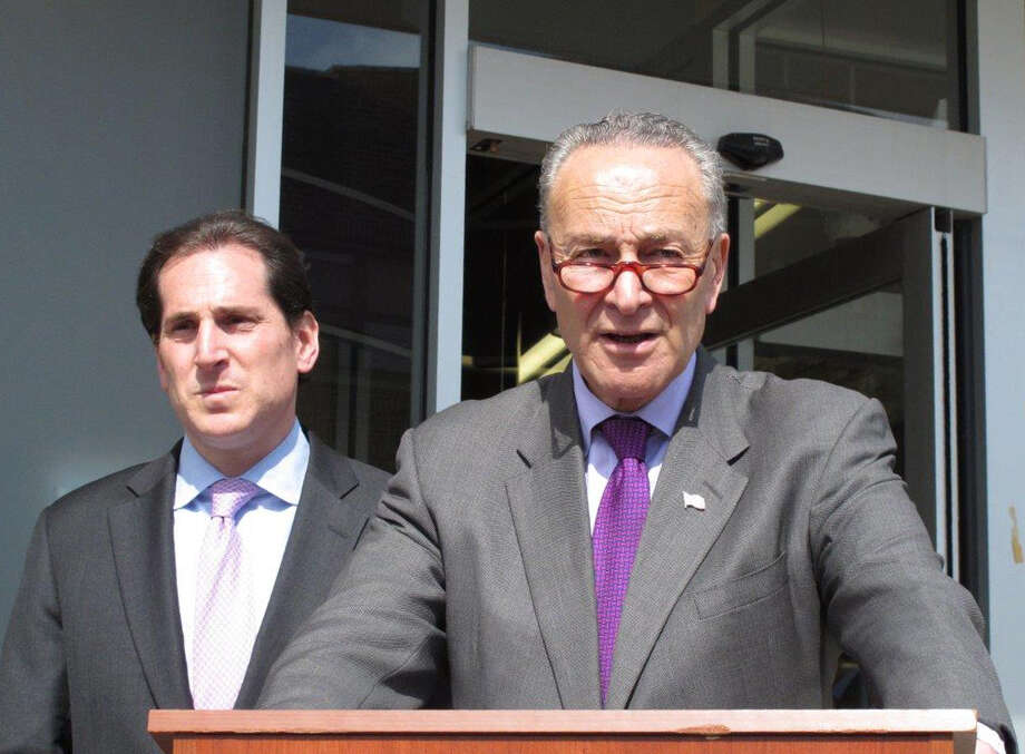 """U.S. Sen. Charles Schumer, right, speaks at a campaign event in Lawrence, N.Y., on Friday, March 11, 2016. Schumer says an alleged Iranian cyberattack on a damn in the suburbs north of New York City is a """"shot across the bow"""" of the United States. He is calling for tougher sanctions against Iran in response. At Schumer's right is Todd Kaminsky, a Democratic candidate for the New York state Senate. (AP Photo/Frank Eltman) ORG XMIT: RPFE101 Photo: Frank Eltman / Copyright 2016 The Associated Press. All rights reserved. This m"""