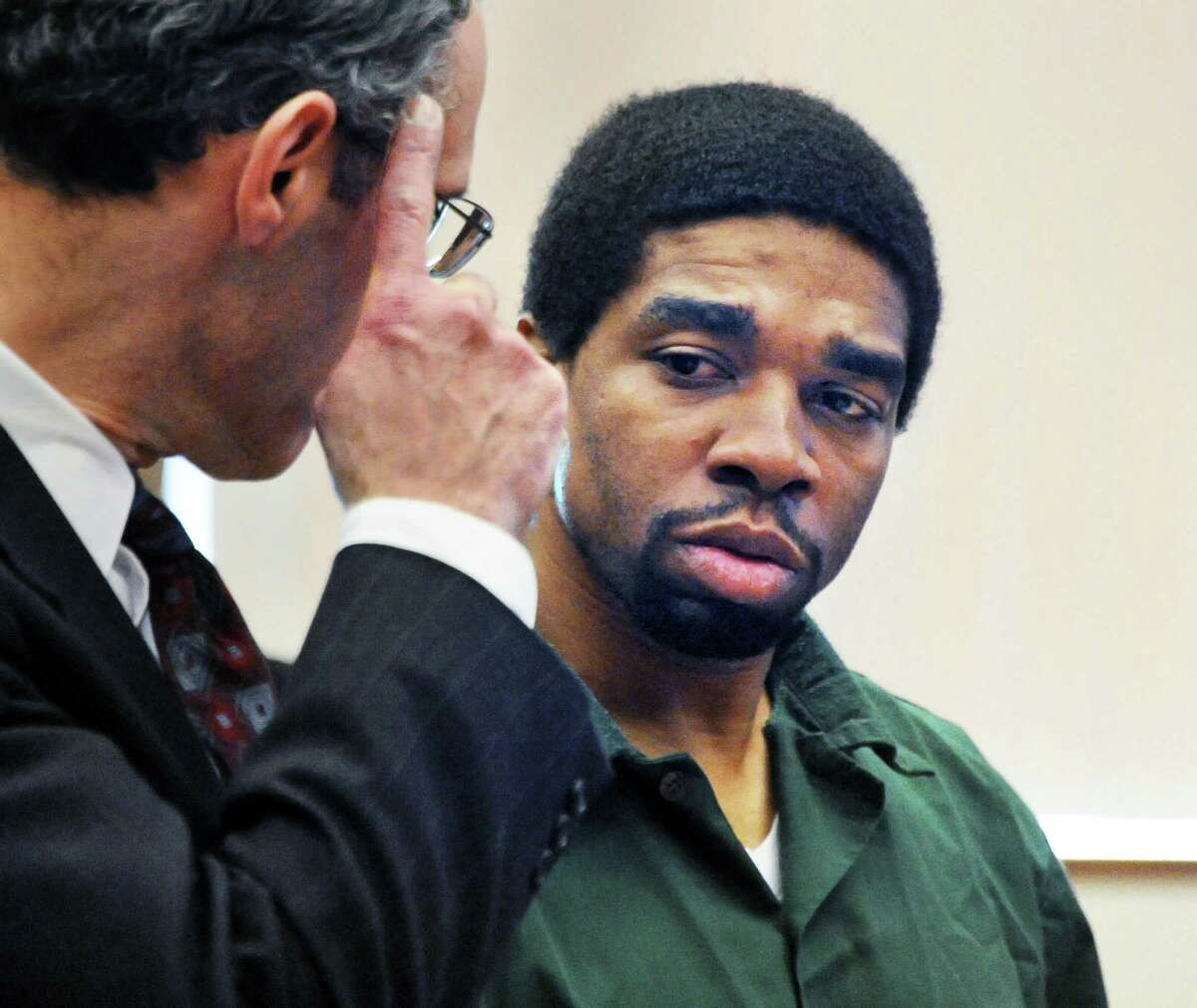 Troy Saunders, right, listens to his defense attorney Adam Parisi during his arraignment in fatal 2014 shooting of Wayne Best Jr. before County Court Judge Matthew Sypniewski Friday March 11, 2016 in Schenectady, NY. (John Carl D'Annibale / Times Union)