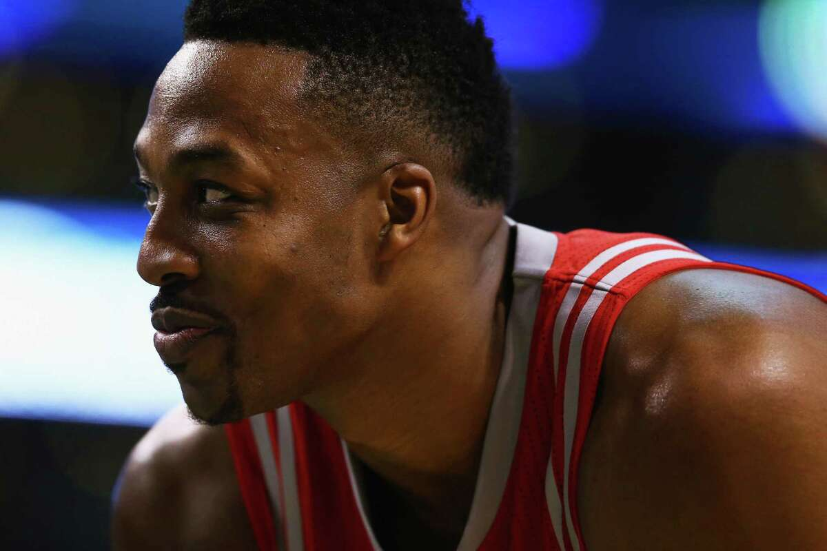 BOSTON, MA - MARCH 11: Dwight Howard #12 of the Houston Rockets looks on during the second quarter against the Boston Celtics at TD Garden on March 11, 2016 in Boston, Massachusetts. NOTE TO USER: User expressly acknowledges and agrees that, by downloading and/or using this photograph, user is consenting to the terms and conditions of the Getty Images License Agreement.