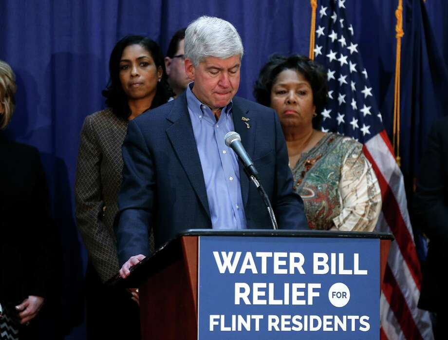 Gov. Rick Snyder listens to a question after attending a Flint Water Interagency Coordinating Committee meeting, Friday, Feb. 26, 2016 in Flint, Mich. The Detroit Free Press and The Detroit News reported Friday that Valerie Brader, Snyder's senior policy adviser and deputy legal counsel, and chief legal counsel Mike Gadola expressed concerns about Flint's water in October 2014, nearly six months after Flint had begun using the river water to save money. (AP Photo/Paul Sancya) Photo: Paul Sancya, STF / Associated Press / AP