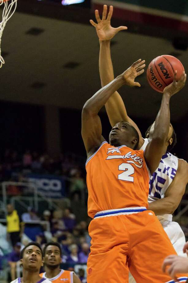 Houston Baptist Huskies guard Athony Odunsi (2) is fouled by a Stephen F. Austin defender late in the second half of the Southland Conference mens basketball semifinal game at the Merrell Center on Friday, March 11, 2016, in Katy, TX. Photo: Joe Buvid, For The Chronicle / © 2015 Joe Buvid