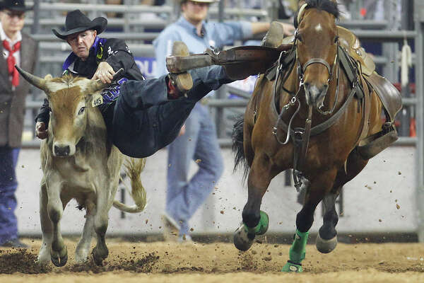 Josh Peek competes in the steer wrestling event during round 2 of the Super Series IV at the Houston Livestock Show and Rodeo at NRG Stadium, Friday, March 11, 2016.