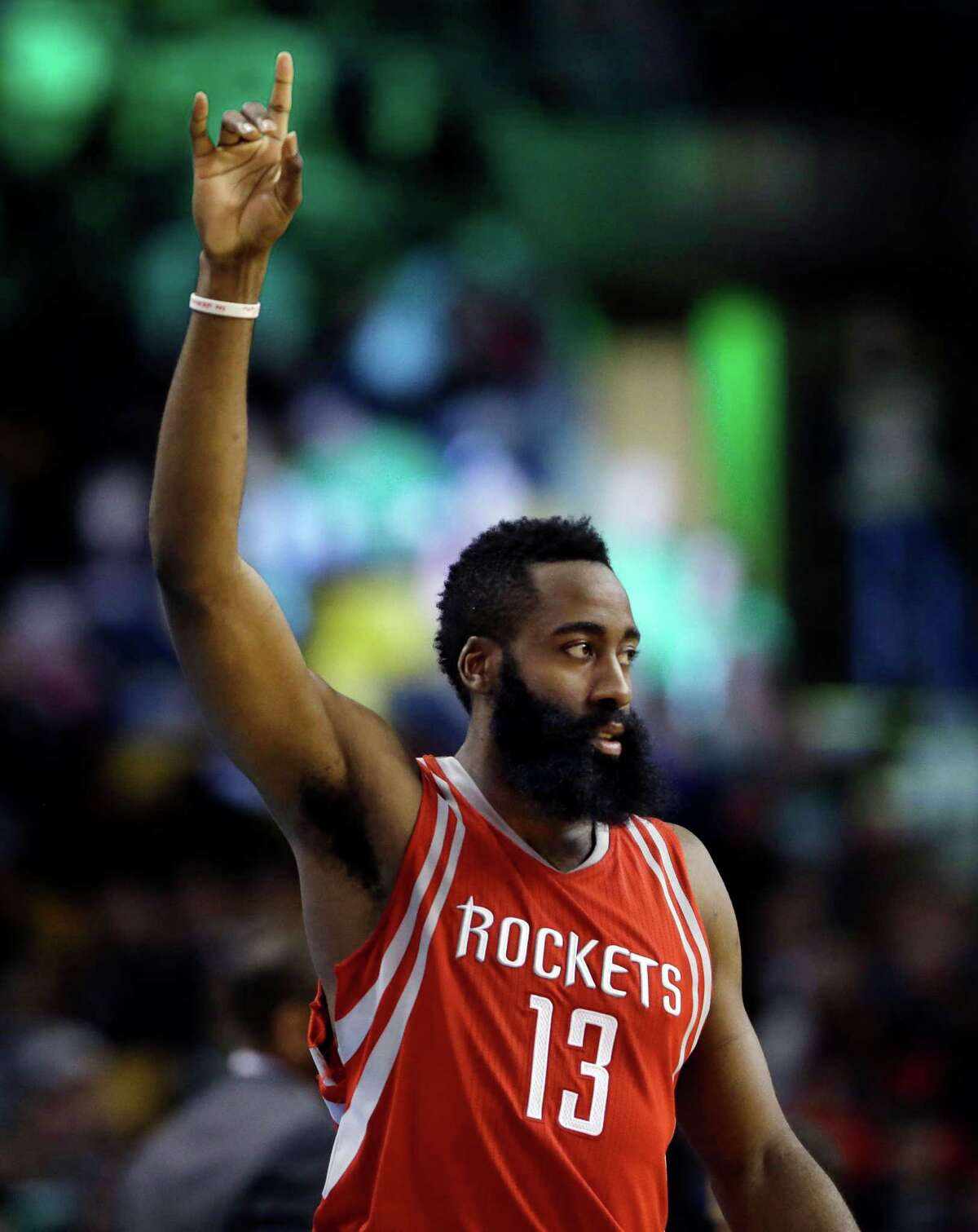 Houston Rockets guard James Harden (13) gestures in the fourth quarter of an NBA basketball game against the Boston Celtics, Friday, March 11, 2016, in Boston. Harden scored 32 points to lead the Rockets to a 102-98 victory over the Celtics.
