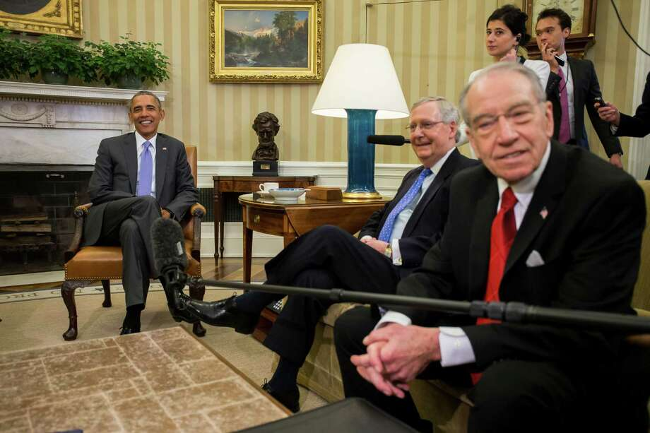 President Barack Obama with Senate Majority Leader Mitch McConnell (R-Ky.) and Sen. Charles Grassley (R-Iowa) in the Oval Office of the White House, in Washington, March 1, 2016. Obama is  to confer on Tuesday with McConnell and Grassley about filling the Supreme Court vacancy left by the death of Justice Antonin Scalia. Vice President Joe Biden was also at the meeting. (Zach Gibson/The New York Times) Photo: ZACH GIBSON, STF / New York Times / NYTNS