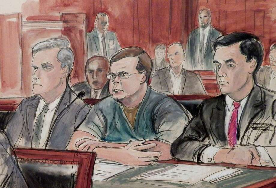 In this courtroom sketch, Evgeny Buryakov, center, and his attorneys Daniel Levin, left, and Scott Hershman attend a federal court hearing, Friday, March 11, 2016, in New York. Buryakov pleaded guilty to conspiracy and agreed to a 2 1/2 year prison sentence. (AP Photo/Elizabeth Williams) ORG XMIT: NYR301 Photo: Elizabeth Williams / Copyright 2016 The Associated Press. All rights reserved. This m