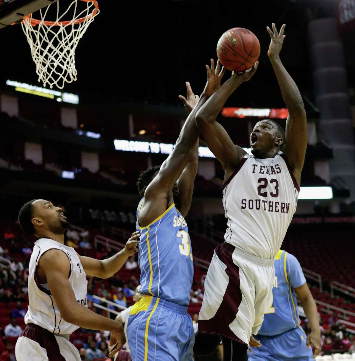 Texas Southern Tigers forward Derrick Griffin (23) shoots over Southern University Jaguars forward D'Adrian Allen (32) during the SWAC basketball tournament Friday, March 11, 2016 at the Toyota Center in Houston.
