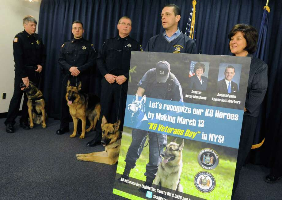 Assemblyman Angelo Santabarbara and State Senator Kathy Marchione held a press conference to push legislation to create a K-9 veterans day to honor deceased military and police dogs on Friday March 11, 2016 in Albany, N.Y.  (Michael P. Farrell/Times Union) Photo: Michael P. Farrell / 10035808A