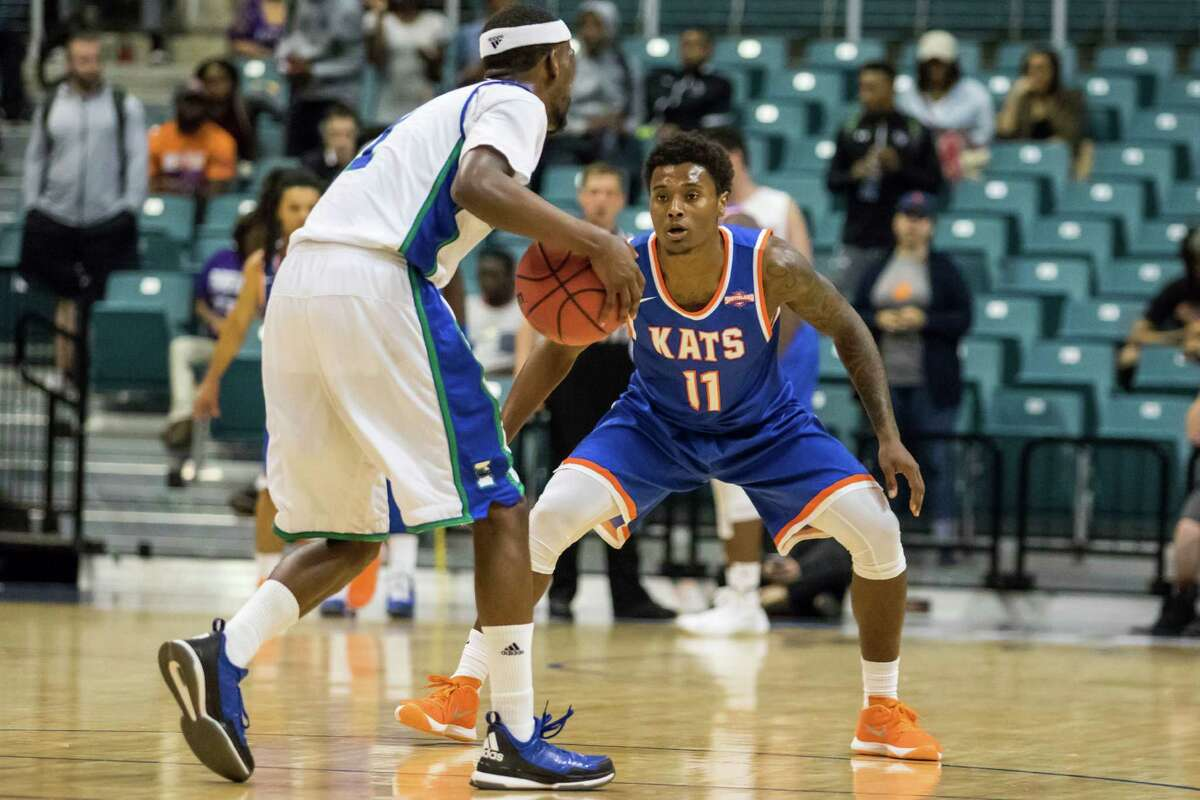 Texas A&M Corpus Christie Islander's guard Hameed Ali (1) is guarded by Sam Houston State Bearkats guard Jalin Barnes (11) in the first half of the Southland Conference mens basketball semifinal game at the Merrell Center on Friday, March 11, 2016, in Katy, TX.