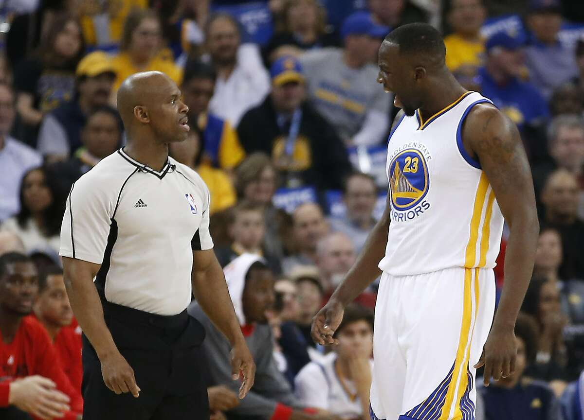 Golden State Warriors forward Draymond Green (23) argues a call with referee Dedric Taylor, left, during the first half NBA game at Oracle Arena in Oakland, Calif., on Friday, March 11, 2016.