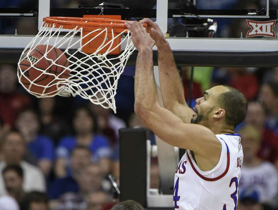 KANSAS CITY, MO - MARCH 11:   Perry Ellis #34 of the Kansas Jayhawks dunks against the Baylor Bears in the first half during the semifinals of the Big 12 Basketball Tournament at Sprint Center on March 11, 2016 in Kansas City, Missouri.  (Photo by Ed Zurga/Getty Images) ORG XMIT: 599937965 Photo: Ed Zurga / 2016 Getty Images