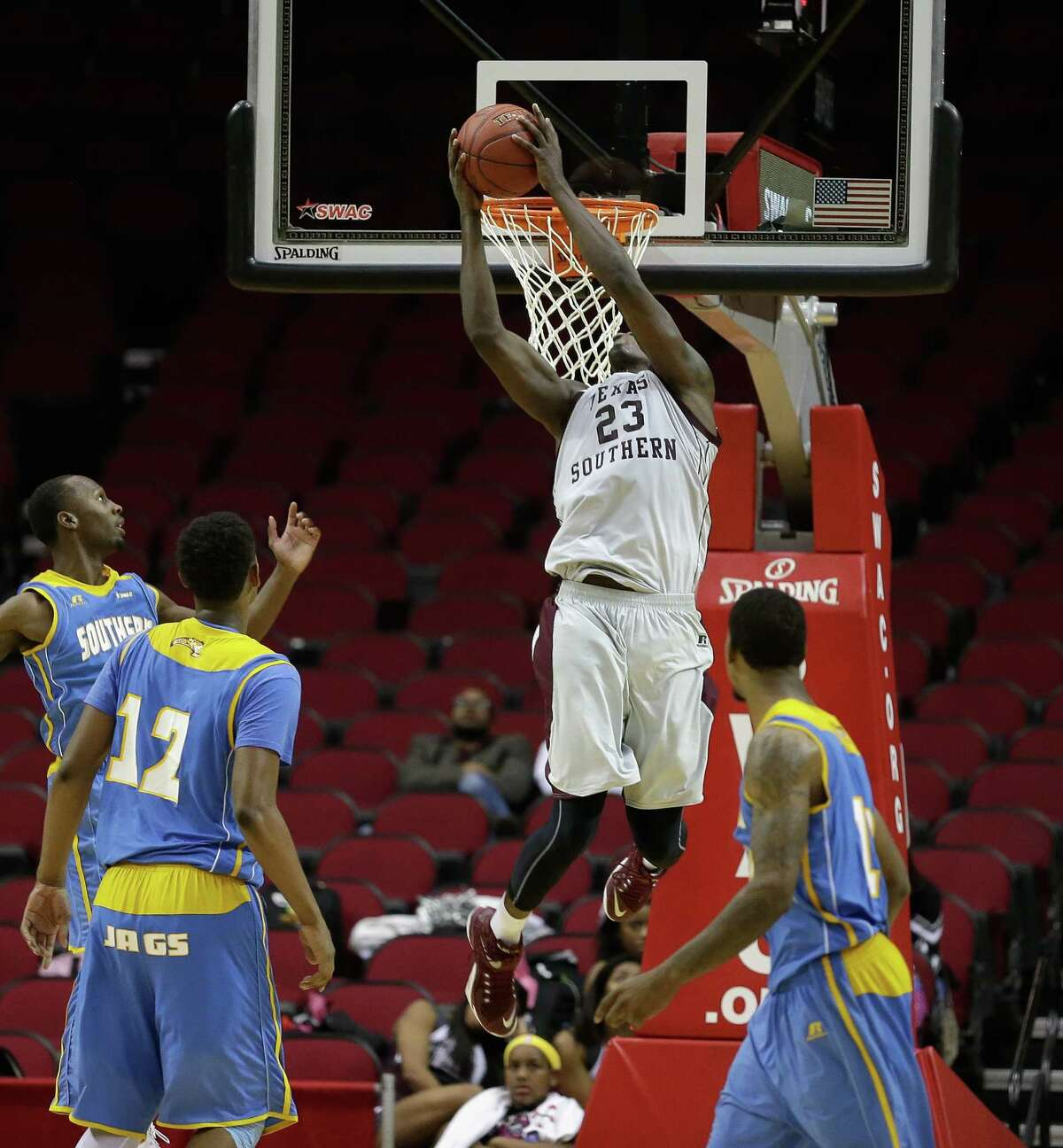Texas Southern Tigers forward Derrick Griffin (23) misses a dunk on a pass from the perimeter as Southern University Jaguars forward Jared Sam (12) looks on during the SWAC basketball tournament Friday, March 11, 2016 at the Toyota Center in Houston.