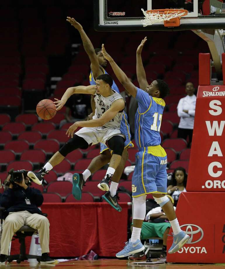 Texas Southern Tigers guard David Blanks (3) passes off as he is sandwiched between Southern University Jaguars forward Shawn Prudhomme (10) and forward Jared Sam (12) in the second half  during the SWAC basketball tournament Friday, March 11, 2016 at the Toyota Center in Houston. Photo: Bob Levey, Houston Chronicle / ©2016 Bob Levey