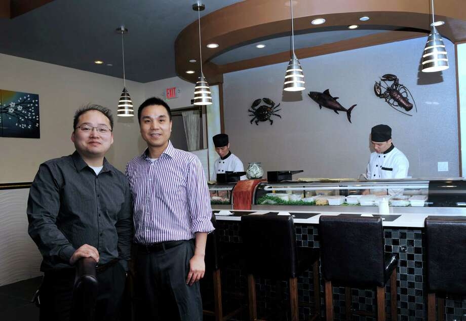 Will Zheng, 35, and David Li, 42, are the owners of Kumo Sushi & Lounge, a recently opened restaurant in New Milford. Photo: Carol Kaliff / Hearst Connecticut Media / The News-Times