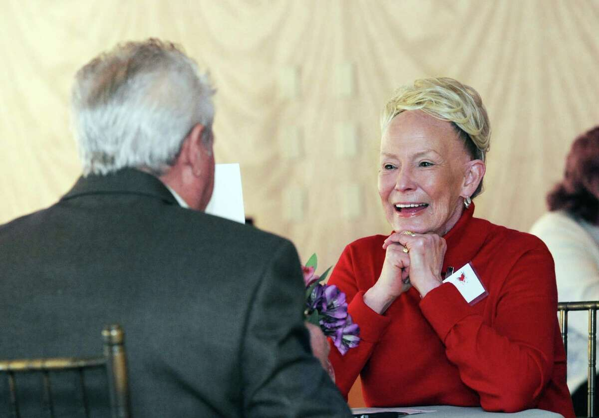 At right, Janet Gold, 70, of Old Greenwich, speaks with potential suitor Pasquale Apruzzese, 83, of Norwalk, during the senior speed-dating event, sponsored by the Stamford Senior Center and SilverSource Inc., at The Waters Edge at Giovanni's in Darien on Friday.