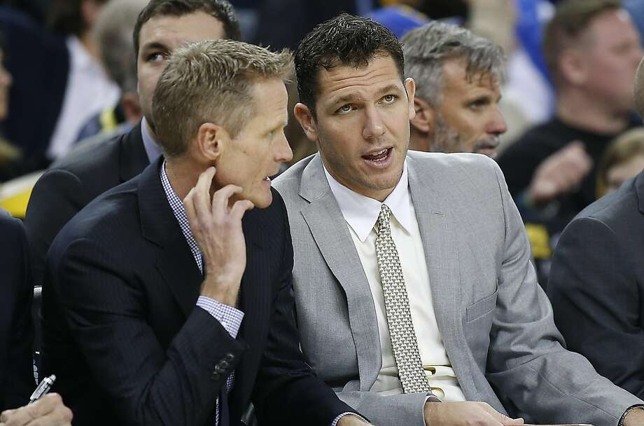 Golden State Warriors head coach Steve Kerr, left, talks with assistant coach Luke Walton during the second half against the Portland Trail Blazers NBA game at Oracle Arena in Oakland on March 11. Photo: Tony Avelar, Special To The Chronicle