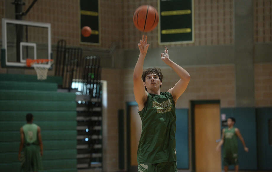 Aaron Sutherland takes a shot as East Chambers gets in practice Friday as they prepare for their state final game Saturday morning at the Alamodome. Photo taken Friday, March 11, 2016 Kim Brent/The Enterprise Photo: Kim Brent / Beaumont Enterprise