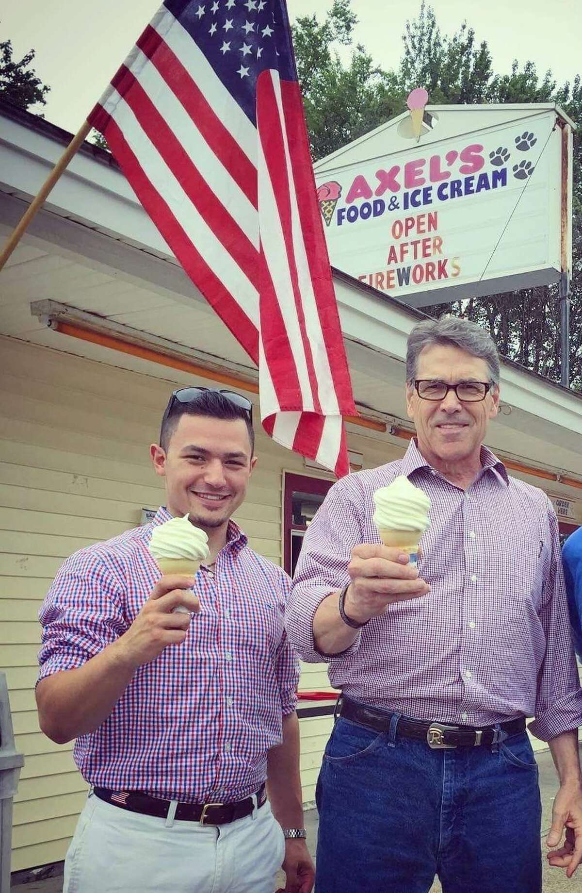 Austin Samuelson of Brookfield with Rick Perry in New Hampshire last summer.