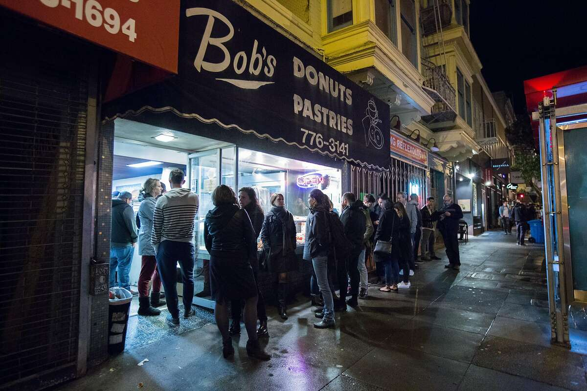 People line up to enter Bob's Donut & Pastry Shop on Friday, March 11, 2016 in San Francisco, Calif. The line regularly spills onto the sidewalk late night.