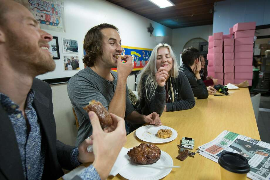 From left: Regular customers Clay Brown, Luke Salisbury and Julie Brown munch on doughnuts at Bob's Donut & Pastry Shop. Photo: Santiago Mejia, Special To The Chronicle