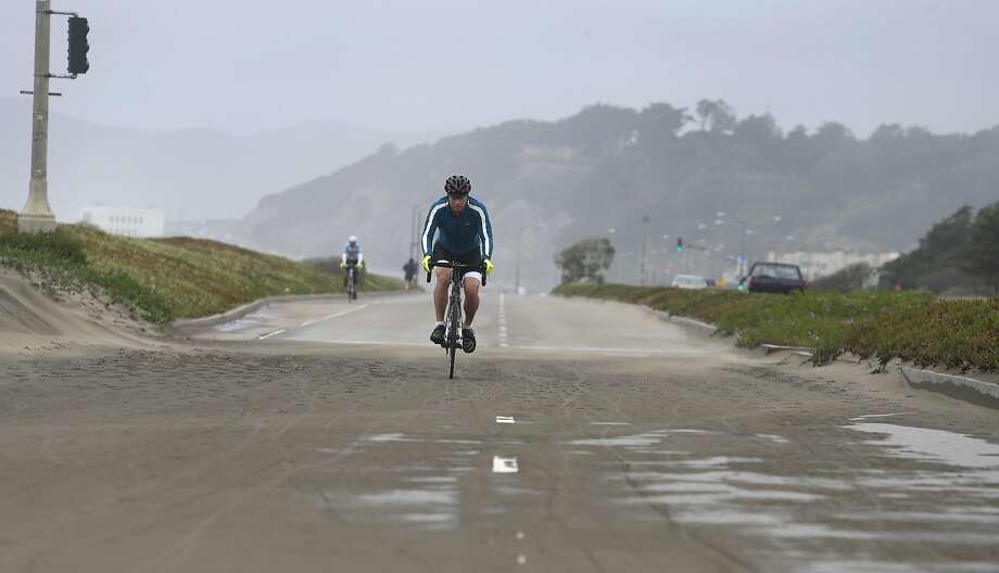 FILE-- Bicyclists ride south on the Great Highway. City officials will close part of the Great Highway on Monday for up to 10 days to keep sand from covering the oceanside road. Photo: Paul Chinn, The Chronicle