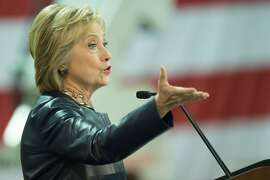 Democratic Presidential candidate Hillary Clinton speaks to supporters at a rally at the Nelson-Mulligan Carpenters' Training Center on March 12, 2016 in St. Louis, Missouri. Democratic frontrunner Hillary Clinton issued a stern warning to Trump after tensions boiled over in Chicago, just days before a crucial new round of presidential nomination votes on Tuesday.  / AFP PHOTO / Michael B. ThomasMICHAEL B. THOMAS/AFP/Getty Images