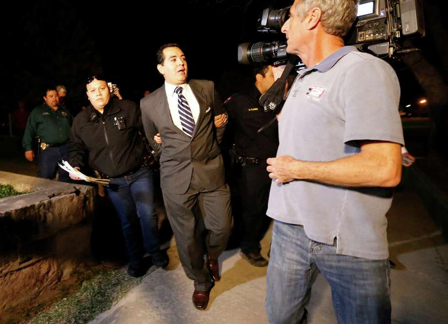 Crystal City Mayor Ricardo Lopez was arrested April 27, 2016 at city hall on harassment charges. Lopez is seen in the photo being arrested in February during a city council meeting. Photo: San Antonio Express-News / File Photo / ©2016 San Antonio Express-News