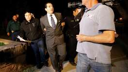 Crystal City Mayor Ricardo Lopez is taken away after a scuffle at City Hall. He's facing federal corrup tion charges.
