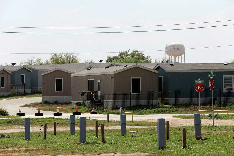 RV slots are seen empty in the foreground as empty mobile homes sit in another lot in Cotulla, Texas, Tuesday, March 8, 2016. Cotulla saw a number of hotels, man camps and RV parks open in responds to the housing demands from the workforce drawn to the area by high paying jobs of the Eagle Ford Shale play. Crude oil prices declined and it led to a drop in drilling and with it the workforce. In late 2014, the Organization of the Petroleum Exporting Countries increased production leading to an oil and price drop. The Texas rig count has dropped by 625 rigs since the start of 2015, to 227 now. Photo: JERRY LARA, Staff / San Antonio Express-News / © 2016 San Antonio Express-News