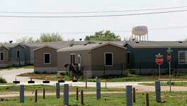 RV slots are seen empty in the foreground as empty mobile homes sit in another lot in Cotulla, Texas, Tuesday, March 8, 2016. Cotulla saw a number of hotels, man camps and RV parks open in responds to the housing demands from the workforce drawn to the area by high paying jobs of the Eagle Ford Shale play. Crude oil prices declined and it led to a drop in drilling and with it the workforce. In late 2014, the Organization of the Petroleum Exporting Countries increased production leading to an oil and price drop. The Texas rig count has dropped by 625 rigs since the start of 2015, to 227 now.