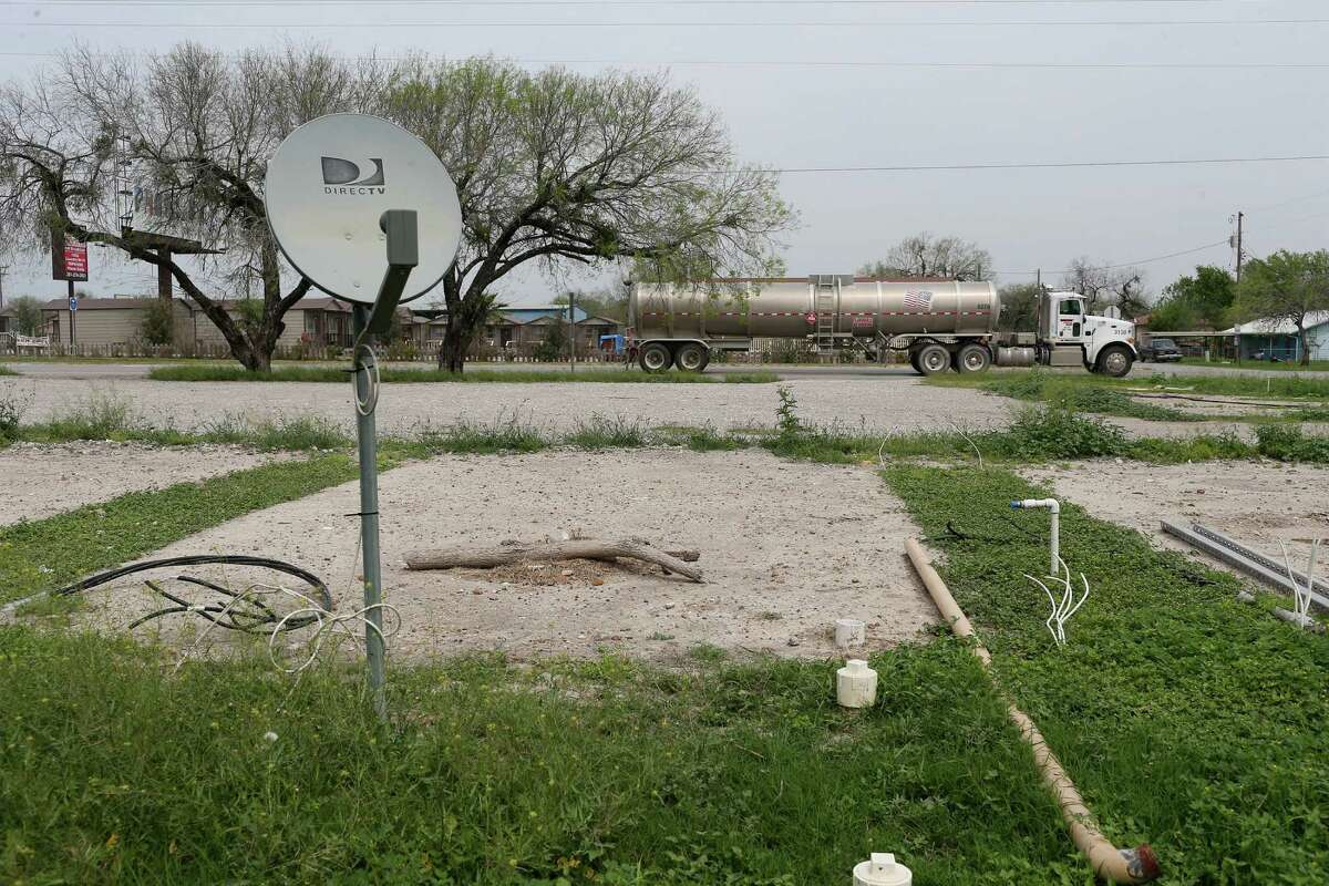 Bare spots mark the site of the former cabin rental business in Tilden, Texas, Tuesday, March 8, 2016. With demand for housing from the Eagle Ford Shale play, entrepreneurs opened temporary housing camps, lodges, hotels and apartments to accommodate the workforce drawn to the area. Crude oil prices declined and it lead to a drop in drilling and the number of workers in the region.