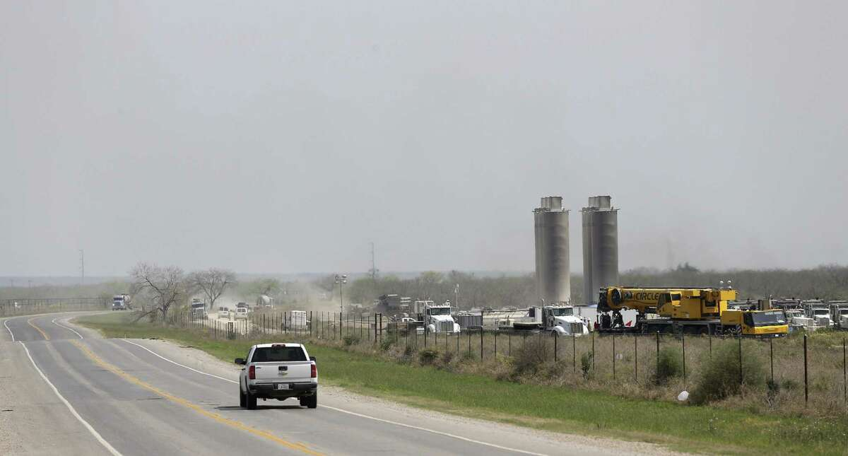 Traffic moves by a fracking site off State Highway 72 between Tilden and Cotulla.