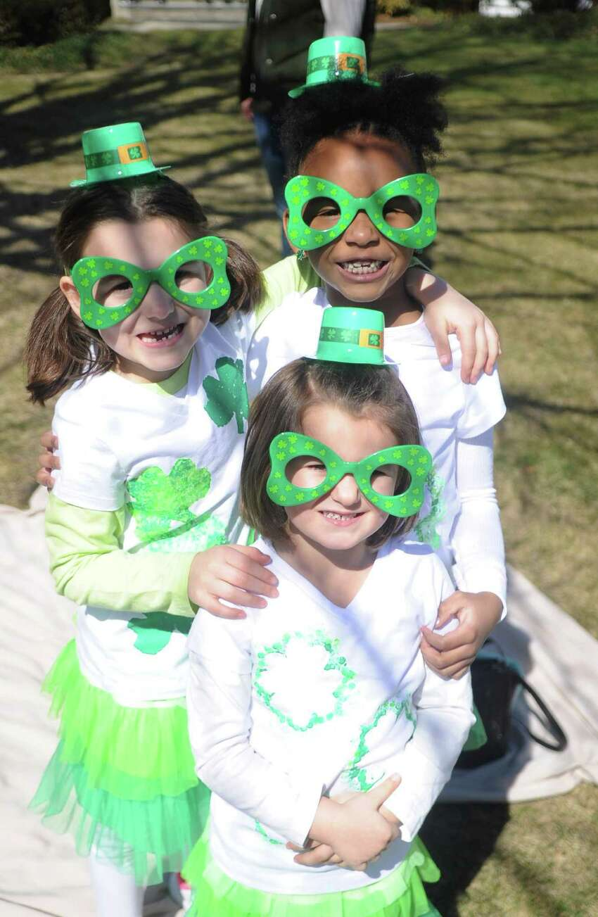 Clockwise from top left, Dakota DiNuzzo, 6, Marley Clarke, 6, and Hailey DiNuzzo, 3, at the St. Patrick's Day Parade in Milford, Conn., on Saturday, March 12, 2016.