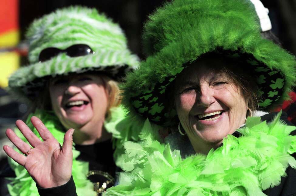Friends Sandy Lovely of Lake Desolation, left, and Myrtle Gauthier of Colonie don their festive wear for the St. Patrick's Parade on Saturday, March 12, 2016, in Albany, N.Y. (Cindy Schultz / Times Union)