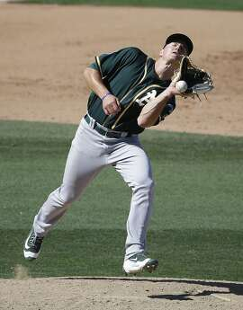 Oakland Athletics' Matt Chapman cannot make a play on a ball hit by Texas Rangers' Elvis Andrus during the fourth inning of a spring training baseball game on Saturday, March 12, 2016, in Surprise, Ariz. (AP Photo/Darron Cummings)