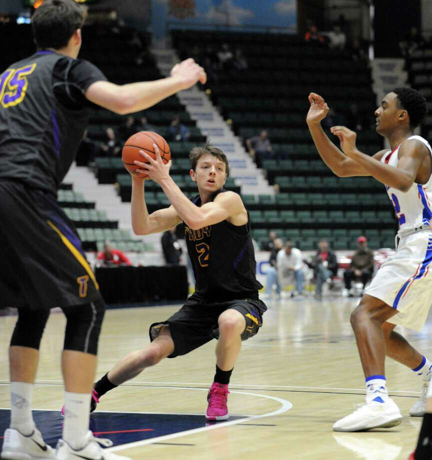 Troy's Ryan Carmello looks to pass during their boys' high school basketball Class A state semifinal against Williamsville South at the Civic Center on Friday March 12, 2016 in Glens Falls, N.Y. Troy won 78-39. (Michael P. Farrell/Times Union) Photo: Michael P. Farrell / 10035774A