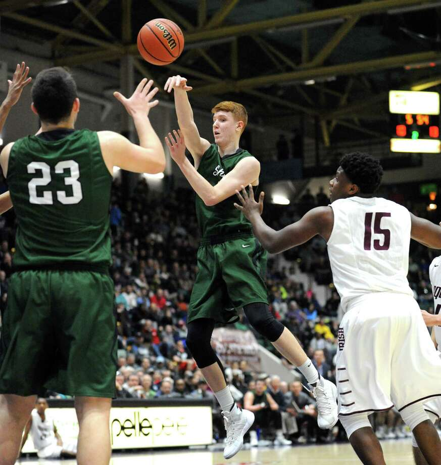 Shen's Kevin Huerter passes the ball off during their boys' high school basketball Class AA state semifinal against Aquinas at the Civic Center on Friday March 12, 2016 in Glens Falls, N.Y. (Michael P. Farrell/Times Union) Photo: Michael P. Farrell / 10035773A