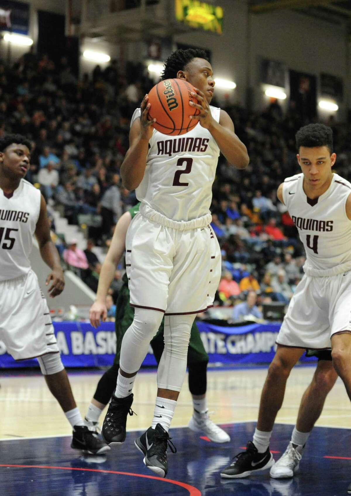 Aquinas's Earnest Edwards pulls down a rebound during their boys' high school basketball Class AA state semifinal against Shennendehowa at the Civic Center on Friday March 12, 2016 in Glens Falls, N.Y. (Michael P. Farrell/Times Union)