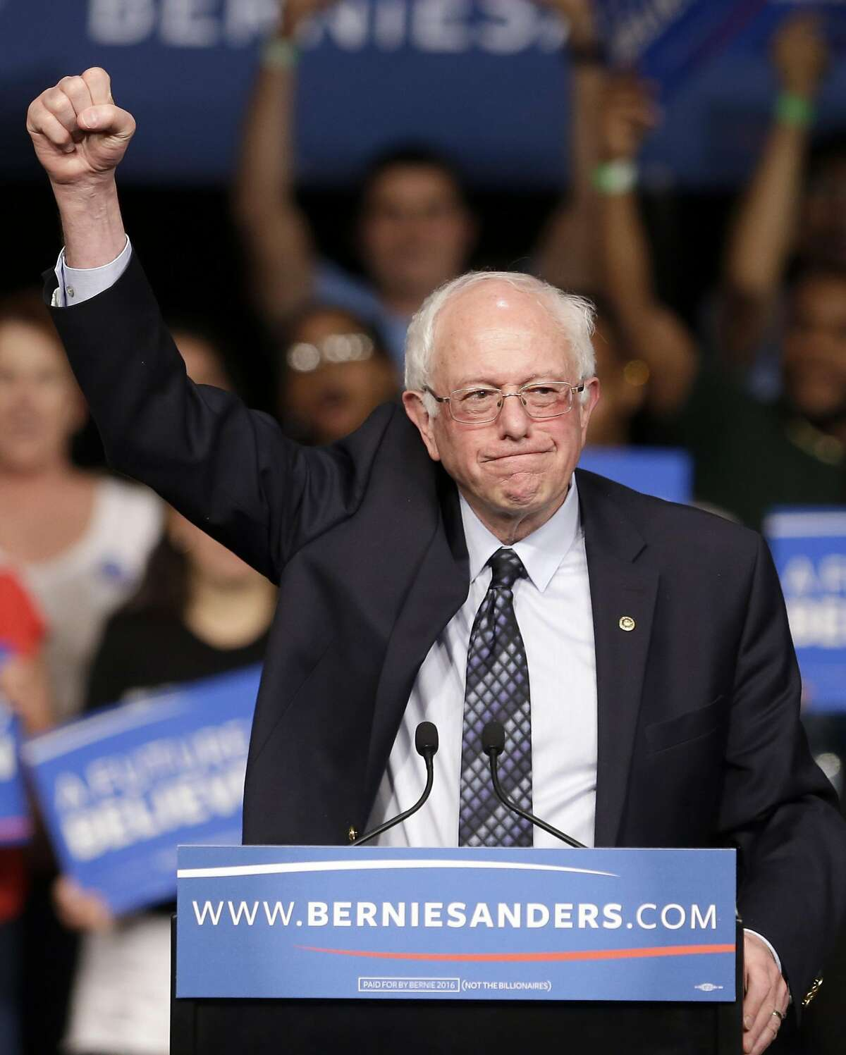 Democratic presidential candidate, Sen. Bernie Sanders, I-Vt. acknowledges his supporters at his arrival at a campaign rally, Tuesday, March 8, 2016, in Miami. (AP Photo/Alan Diaz)