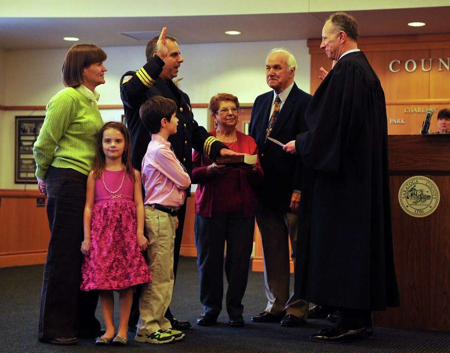 Richard Castle, formerly chief deputy of Saratoga County Sheriff Department, swears in as the new undersheriff with his family beside him on Friday, March 11, 2016, in Ballston Spa, N.Y. (Brittany Gregory / Special to the Times Union) Photo: Brittany Gregory / 10035799A