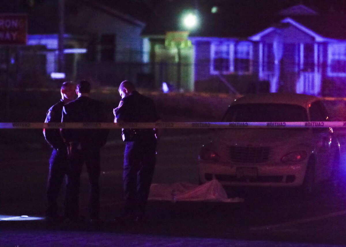Houston Police investigate a fatal officer-involved shooting at the intersection of Collingsworth Street and the Eastex Freeway, Saturday, March 12, in Houston. ( Jon Shapley / Houston Chronicle )