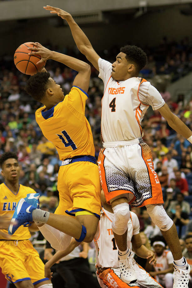 Elkins senior guard Chad Bowie, left, works to the hoop against Lancaster senior guard Ike Durham (4) in the 2nd quarter of  their Class 5A boys basketball state championship game at the Alamodome in San Antonio on Saturday, Mar. 12, 2016. (Photo by Jerry Baker/Freelance) Photo: Jerry Baker, For The Houston Chronicle