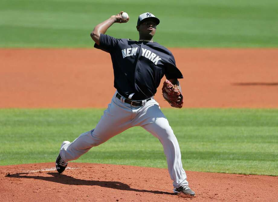 New York Yankees starting pitcher Luis Severino works against the Tampa Ba Rays in the first inning of spring training baseball game, Saturday, March 12, 2016, in Port Charlotte, Fla. (AP Photo/Tony Gutierrez) ORG XMIT: FLTG107 Photo: Tony Gutierrez / Copyright 2016 The Associated Press. All rights reserved. This m