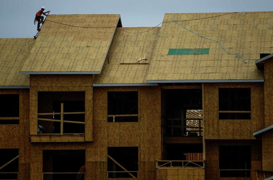 A construction worker builds an apartment complex in Baytown in May 2016. Photo: Michael Ciaglo Michael Ciaglo, Staff / © 2016  Houston Chronicle