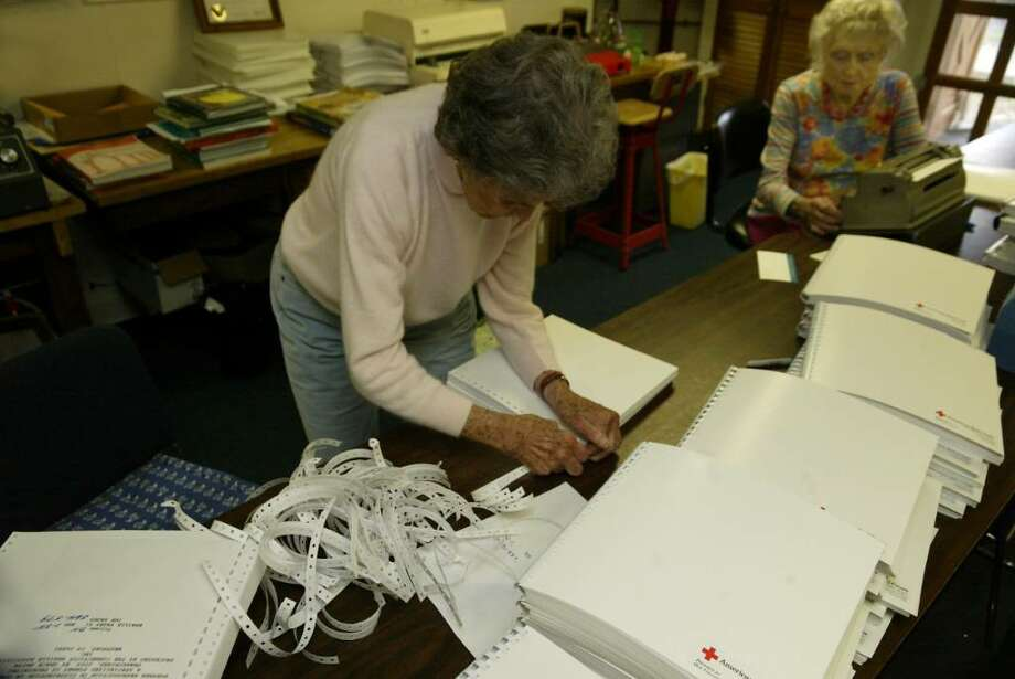 Volunteers (L-R), Theresa Searl and Peggy Catlin bind books for the blind, Tuesday, April 6, 2010, at the Connecticut Braille Association in Westport. Photo: Phil Noel / Connecticut Post