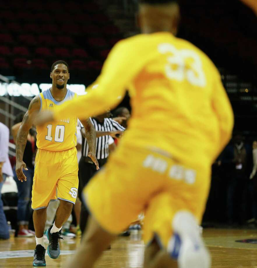 Southern University Jaguars forward Shawn Prudhomme (10) reacts at the final buzzer during the SWAC  mens basketball tournament championship Saturday, March 12, 2016 at the Toyota Center in Houston. Southern won 54-53. Photo: Bob Levey, Houston Chronicle / ©2016 Bob Levey