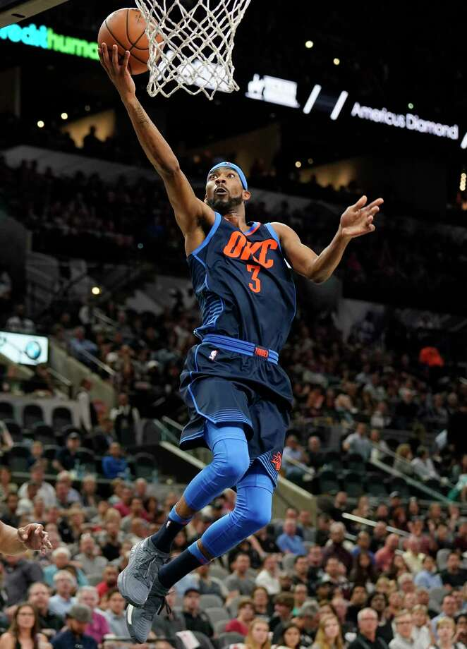 Oklahoma City Thunder forward Paul George (13) collides with San Antonio Spurs guard Manu Ginobili (20) during the first half of an NBA basketball game, Friday, Nov. 17, 2017, in San Antonio. (AP Photo/Eric Gay) Photo: Eric Gay, Associated Press / Copyright 2017 The Associated Press. All rights reserved.