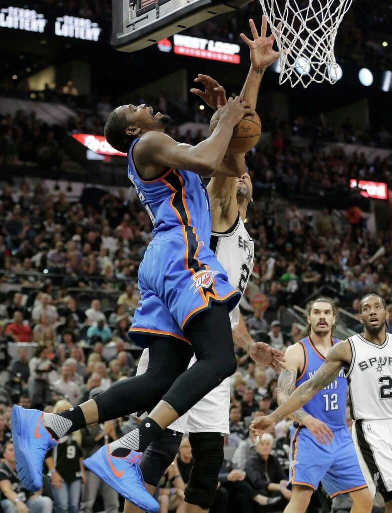 okc s steven adams is tuning out tim duncan san antonio express news oklahoma city thunder forward kevin durant left is fouled by san antonio spurs forward