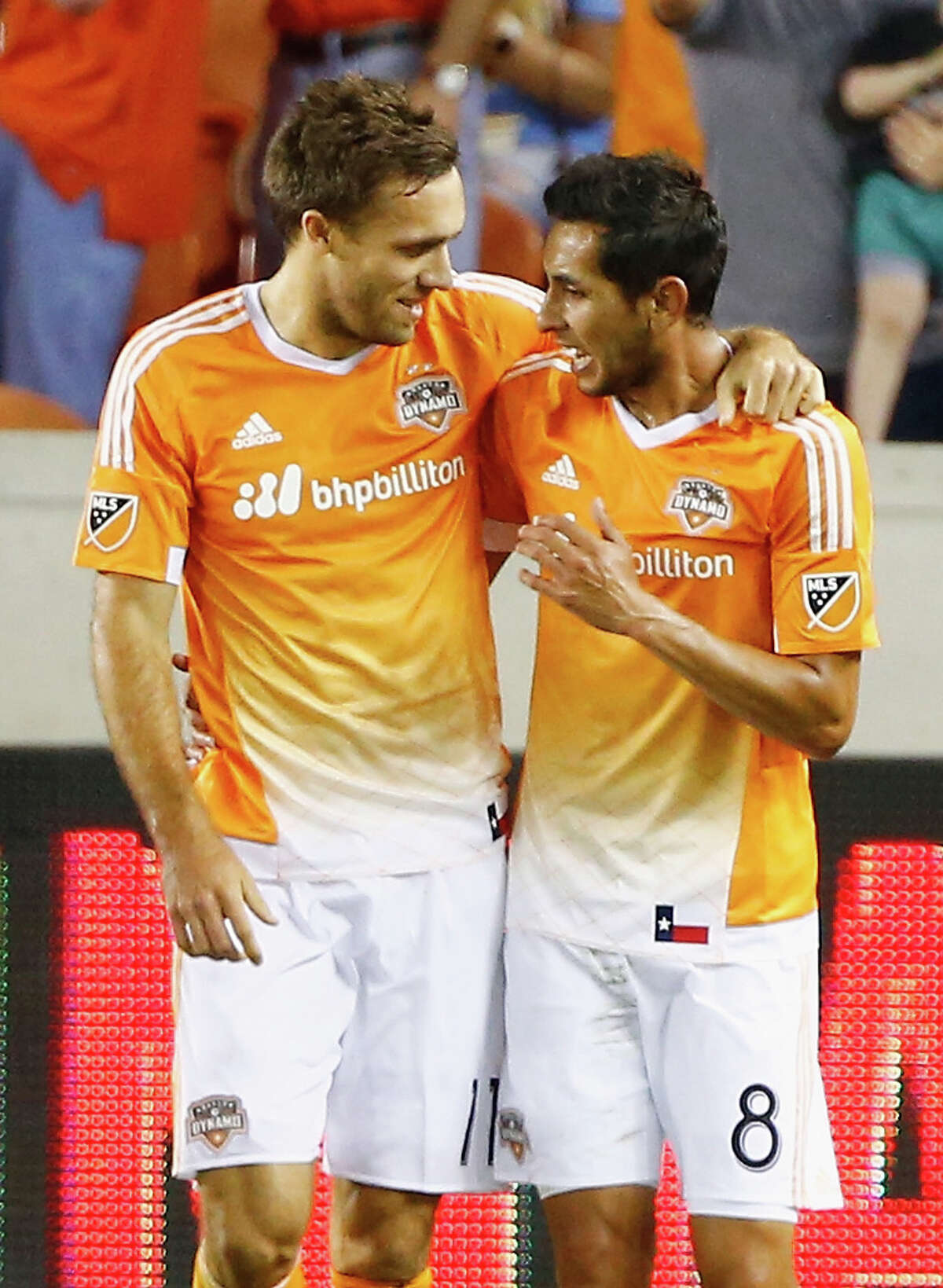 HOUSTON, TX - MARCH 12: Andrew Wenger #11 and Cristian Maidana #8 of Houston Dynamo celebrate after Wenger scored the fourth goal of the first half against FC Dallas during their game at BBVA Compass Stadium on March 12, 2016 in Houston, Texas.