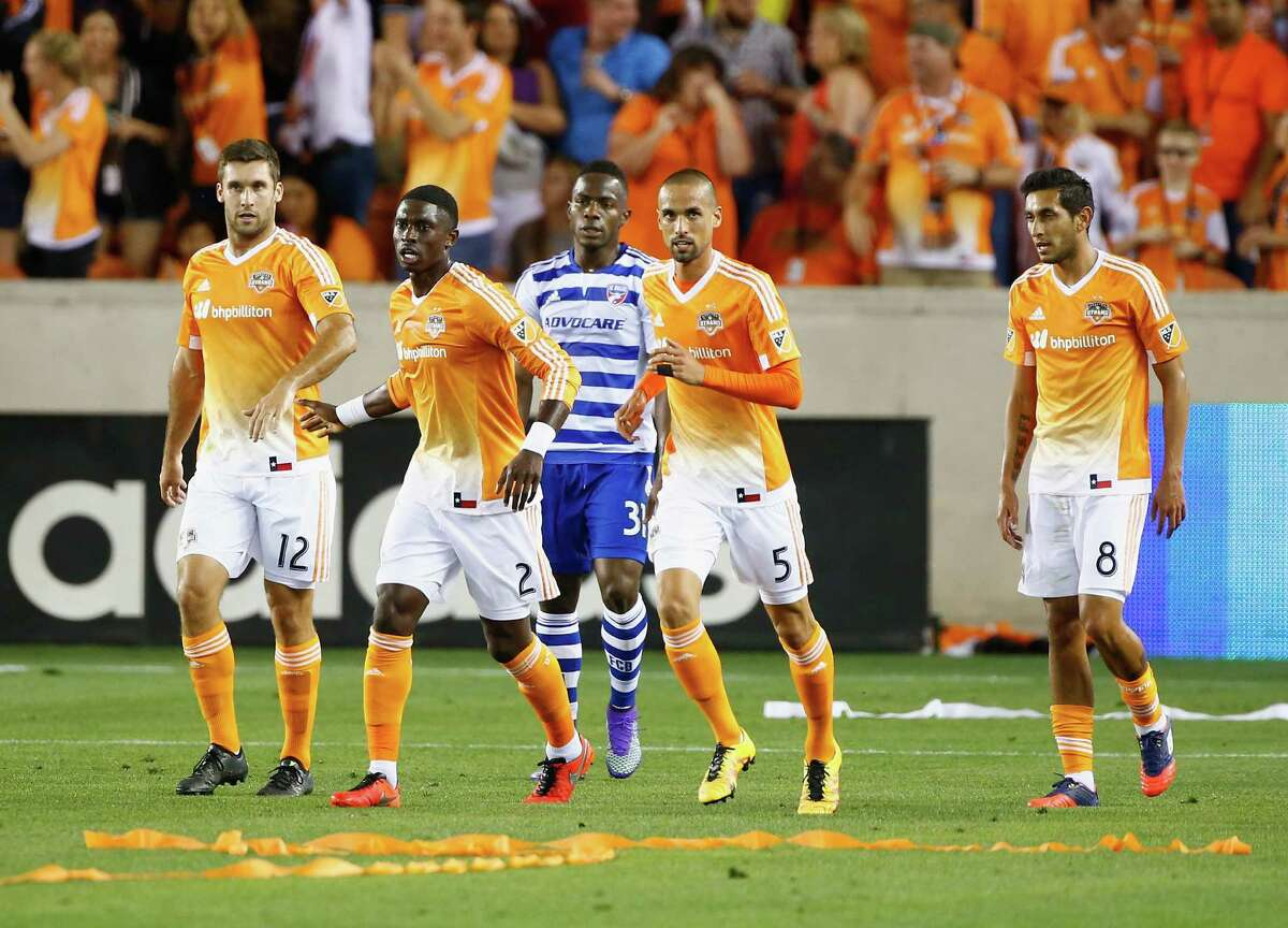 HOUSTON, TX - MARCH 12: Members of Houston Dynamo celebrate after Andrew Wenger #11 of Houston Dynamo scored the fourth goal of the first half against FC Dallas during their game at BBVA Compass Stadium on March 12, 2016 in Houston, Texas.